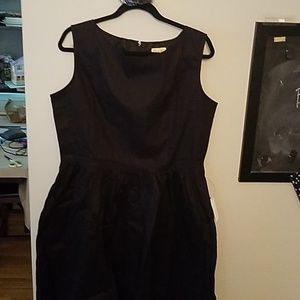Black sleeveless A-line dress with belt